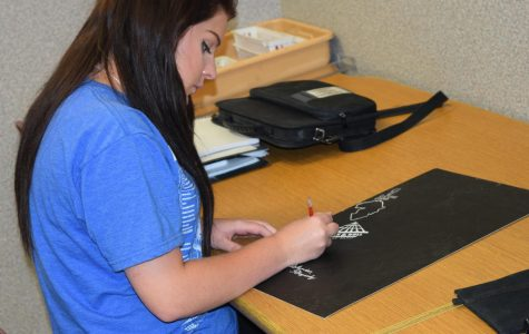 Junior Marissa Spires works on a scratchboard project.