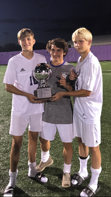 Josiah Blackerby, Owen Chandler, and Cameron Connell hold the O-Cup.