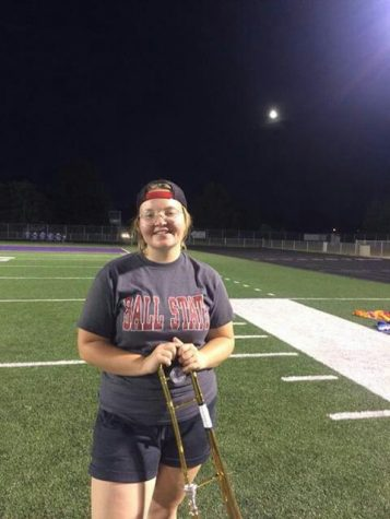 Pictured: Abby Wheeler smiles with many emotions as it is her last evening practice for band.