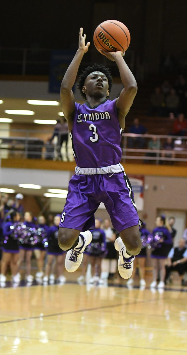 Tribune Photo by Jeff Lubker/ Seymour Eddie Louden shoots the ball on Tuesday during Seymour's game against Jennings County at the Seymour Sectional.