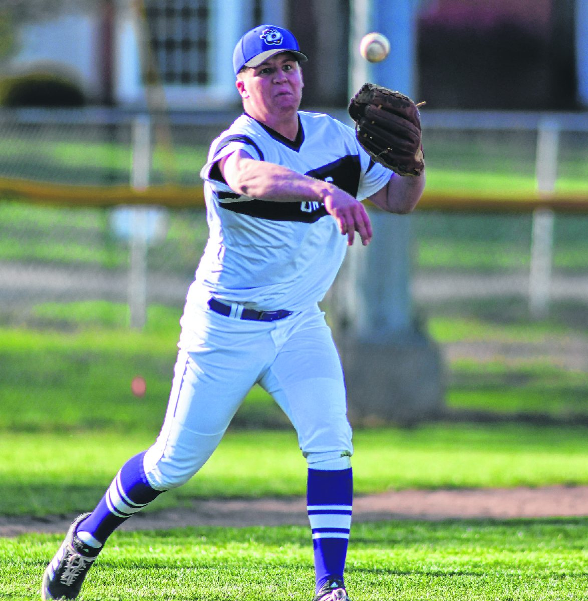 Seymour pitcher Jayden Brown throws the ball to first base for an out during a game against Jennings County on Friday.