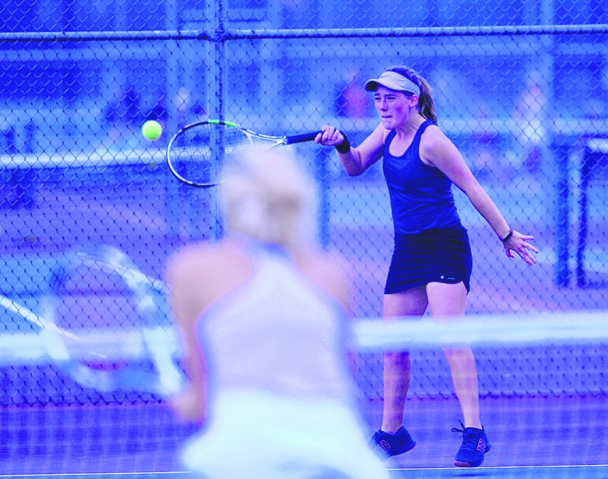 Seymour's Madison Pifer hits a forehand during a sectional match against Scottsburg.