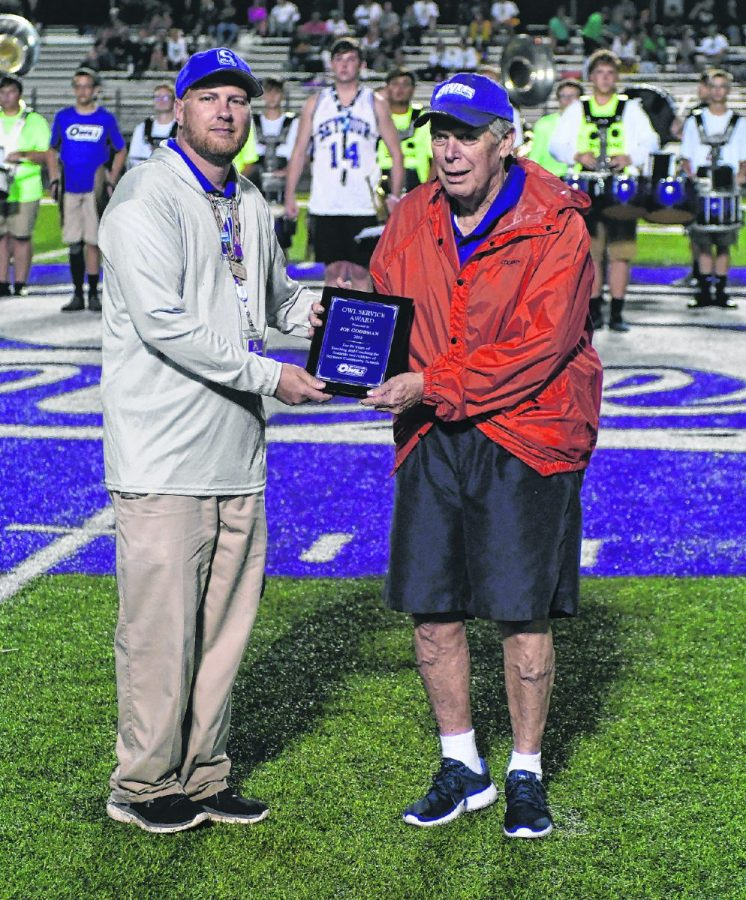 Seymour High School assistant athletic director Dave Urbanski presents former football coach Joe Goodman with the Owls Service Award at Bulleit Stadium on Sept. 7, 2018.