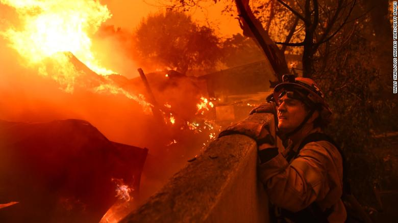 MALIBU, CALIFORNIA NOVEMBER 9, 2018-Mayor and firefighter Rick Mullen surveys a house that is on fire in Malibu as the Woolsey Fire comes down the hill Friday. (Wally Skalij/Los Angeles Times)