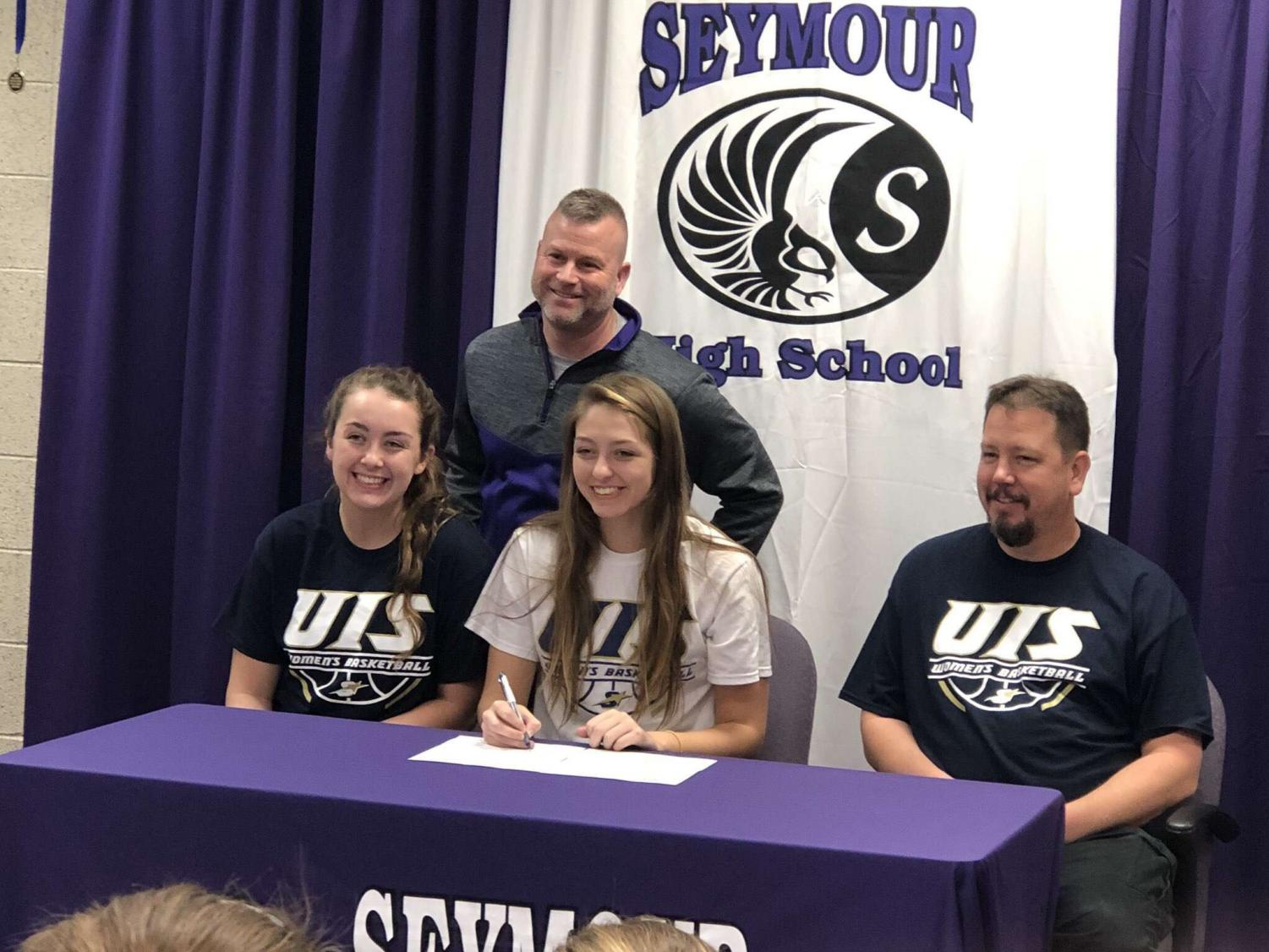 Makenna Fee (middle) with her sister (left), father (right), and Seymour coach Jason Longmeier(top)