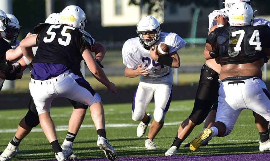 Chandler Dummond hits the hole for a nice gain during Saturday's scrimmage.  Dylan Trimpe | The Tribune