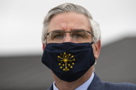 Indiana Governor Eric Holcomb wearing a mask in Kokomo, Indiana.