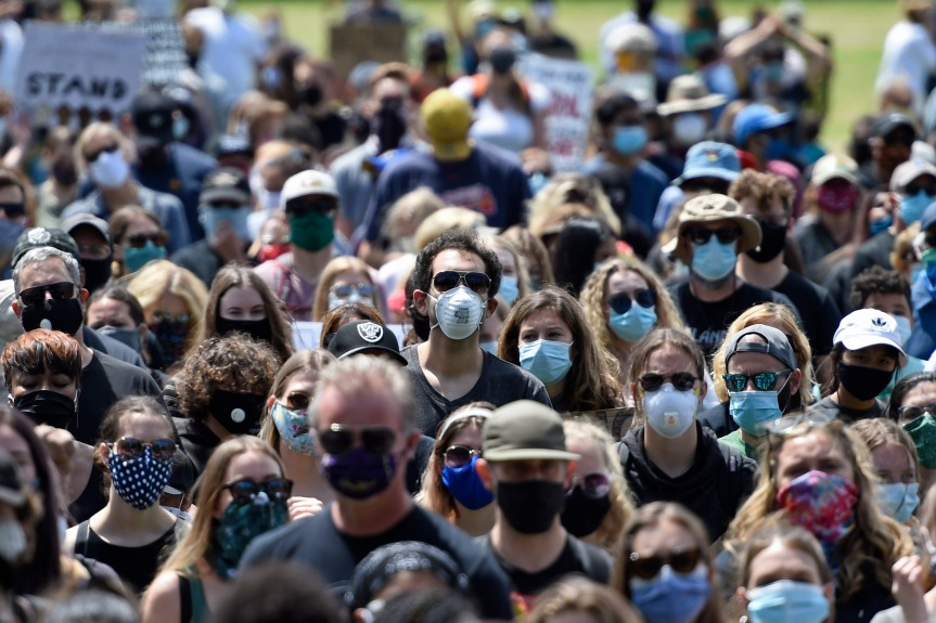 Masked+protestors+during+a+Black+Lives+Matter+rally+in+June+2020.